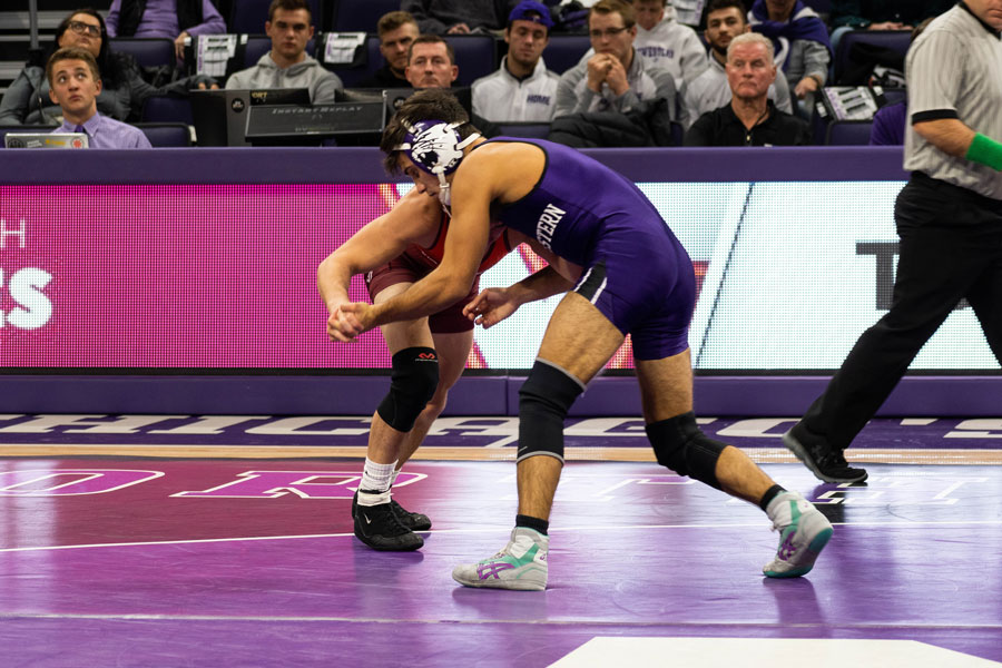 Sebastian Rivera takes on an opponent. The junior earned a 13-4 win in this weekend's match.