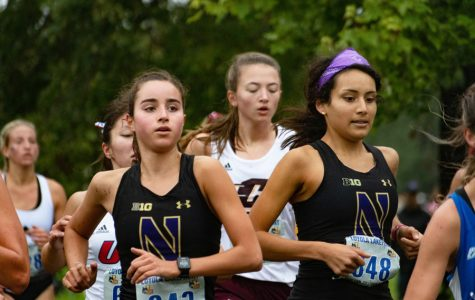 Kayla Byrne runs in a crowded pack of athletes. The freshman finished her 6k Friday with a time of 22:53.7.