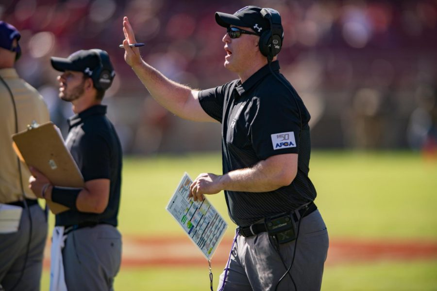 Pat Fitzgerald calls over his players. Fitzgerald will need to hire a new offensive coordinator and quarterbacks coach this offseason.