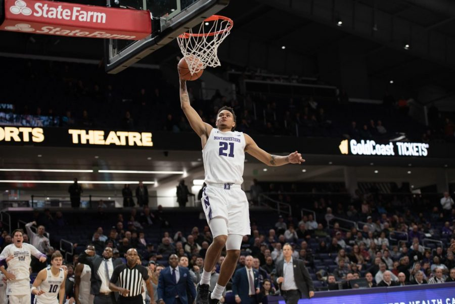 (Daily file photo by Joshua Hoffman). A.J. Turner dunks the ball. Turner is the lone player on Northwestern who's played four seasons of college basketball