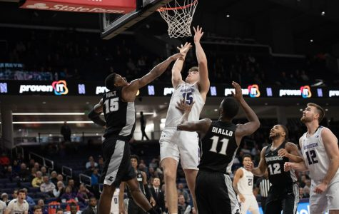 (Daily file photo by Joshua Hoffman). Ryan Young takes a layup. The freshman center scored a career-high 25 points Sunday.