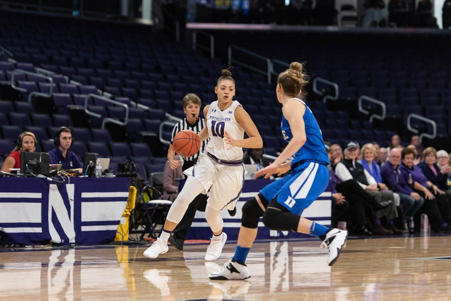 (Daily file photo by Katie Pach). Lindsey Pulliam drives the lane. The junior guard scored a season-high 27 points Saturday.