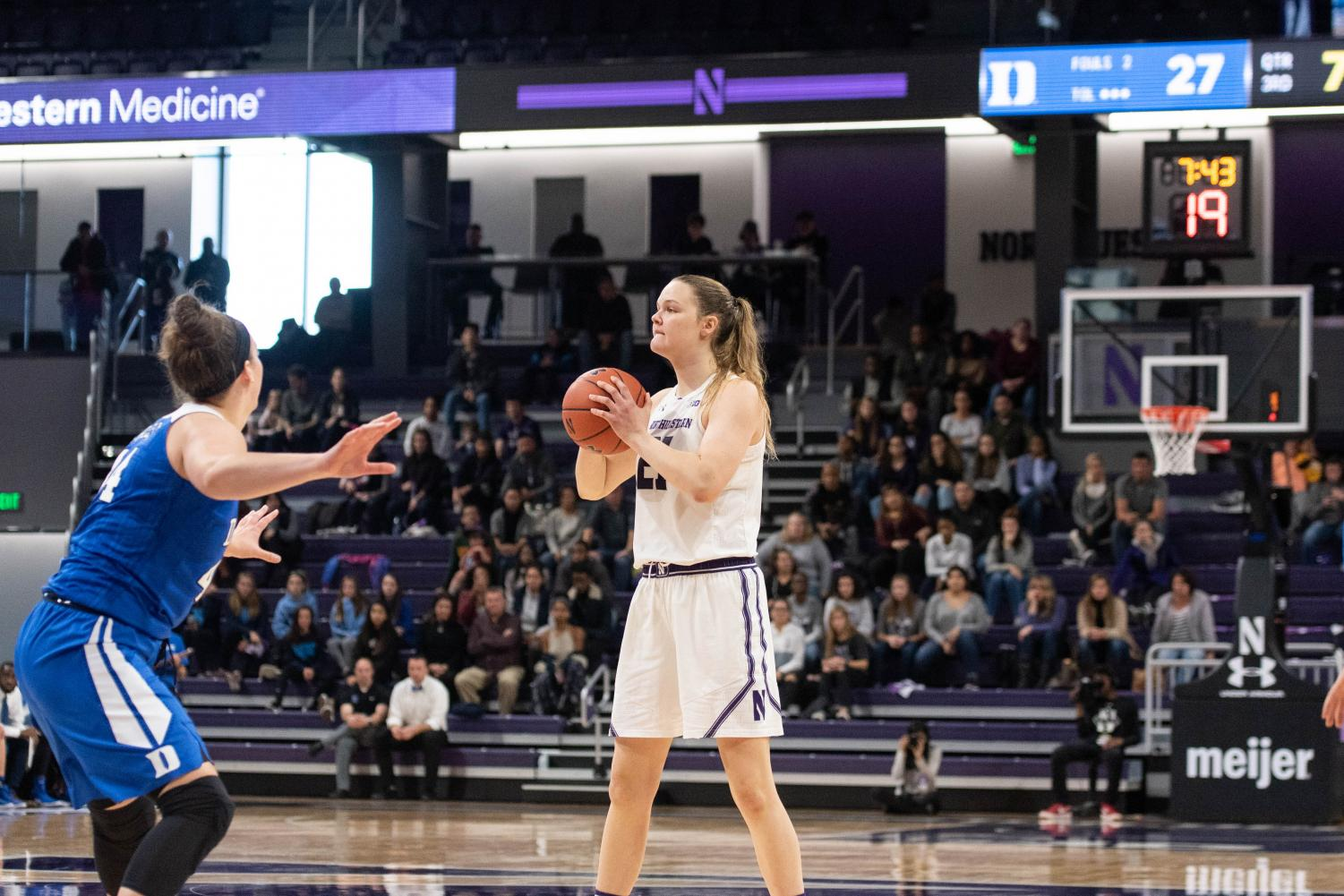 Abbie Wolf holds the ball. The senior center scored a team-high 18 points in NU's loss to DePaul on Sunday.