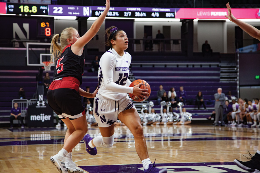 Veronica Burton attempts a layup. The sophomore guard had a clutch steal for the Cats to help NU pull out the victory.