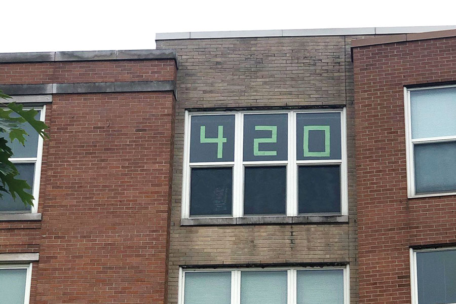 A 420 sign is on display from a window in Slivka Residential College. Following the legalization of recreational cannabis in Illinois, cannabis use among students on campus may be subject to change in the near future.