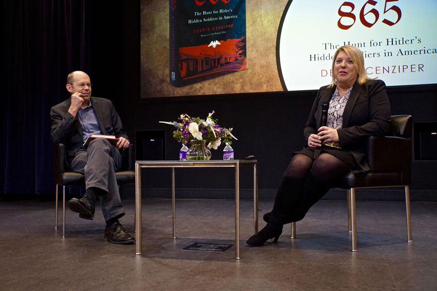 """Medill Profs. Alex Kotlowitz and Debbie Cenziper in the McCormick Foundation Center Thursday. Kotlowitz moderated a discussion of Cenziper's book """" """"Citizen 865: The Hunt for Hitlers Hidden Soldiers in America,"""" which follows a team of Nazi hunters in the U.S. Department of Justice."""