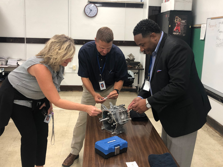 Devon Horton (right) visits one of Jefferson County Public Schools' alternative schools after it instituted Career and Technical Education. Horton will become District 65's superintendent in July.