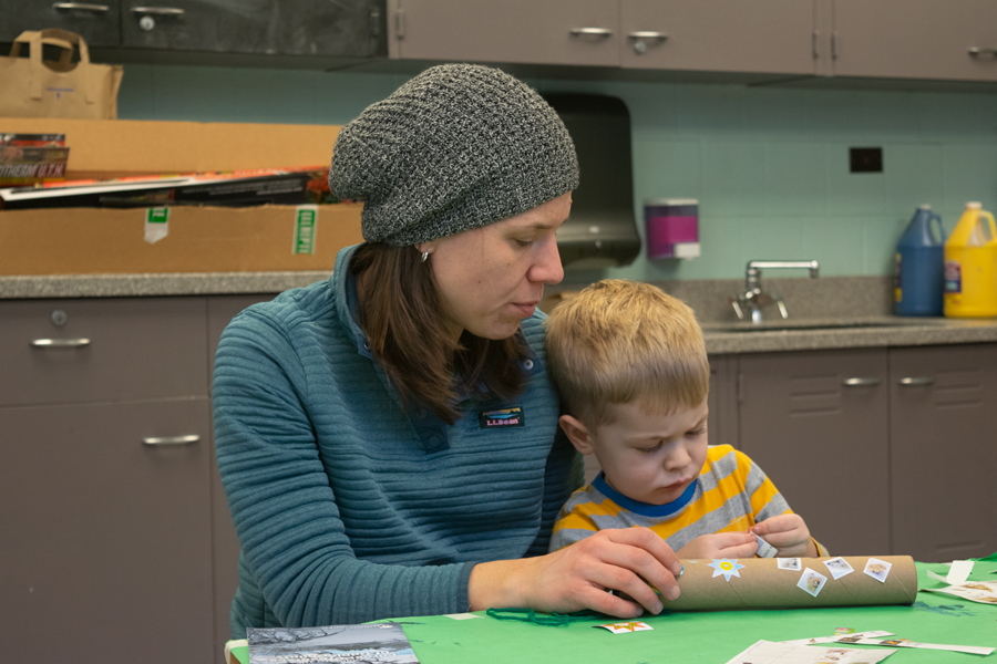 "During the first lesson of ""Saplings and Oaks"" at the Evanston Ecology Center, Tommy Blomquist decorates his paper towel telescope as his mother, Annie Sutula, holds it stable. The EEC educates the community on the environment year-round."