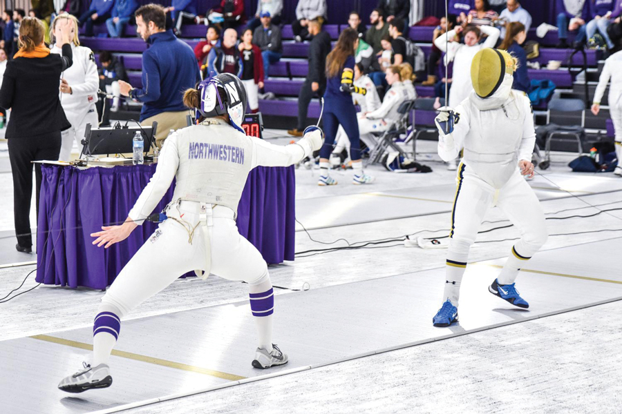 A Northwestern fencer faces off with her opponent. The Wildcats have faced a difficult slate of matchups so far.