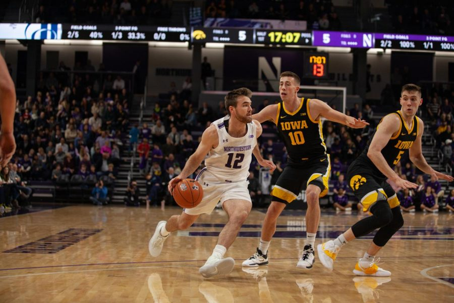 Pat Spencer dribbles the ball. The Wildcats lost to Iowa at home on Tuesday.