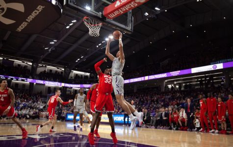 (Joshua Hoffman/ The Daily Northwestern). Pete Nance shoots a layup. Northwestern's offense struggled from the field in a loss to Ohio State.