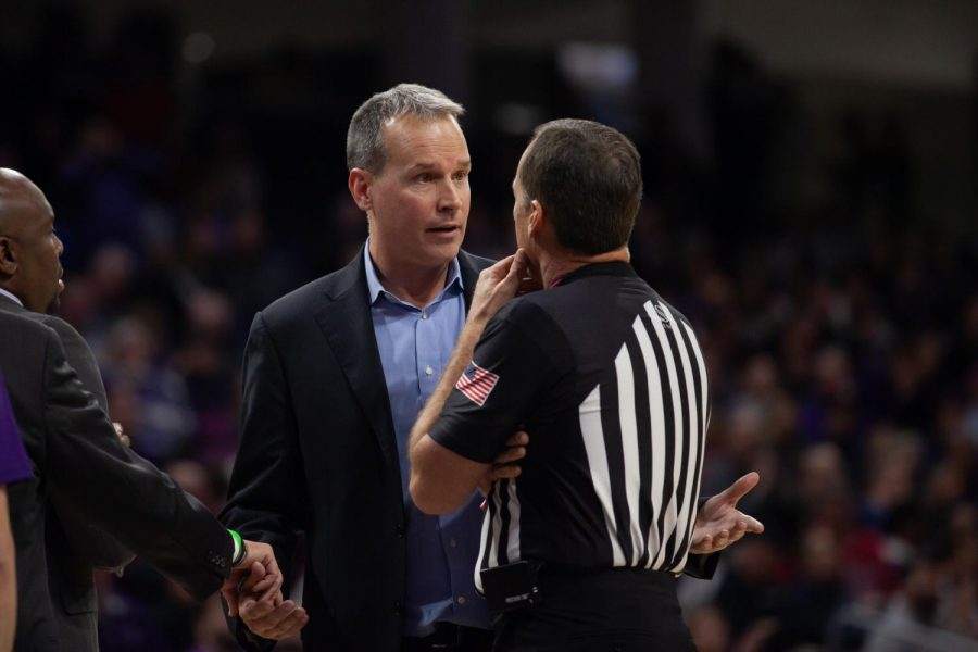 Chris Collins speaks with a referee. The Wildcats have struggled to draw fans this season.