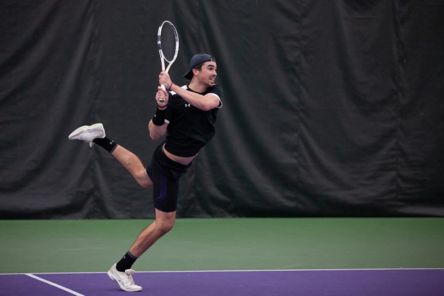 Nick Brookes follows through on a shot. The junior won both his singles matches this weekend against Memphis and IUPUI.