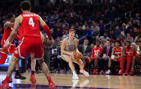Miller Kopp sets up for a shot. The junior finished with a team-high 20 points in NU's loss to Ohio State.