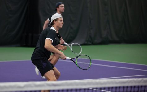 Nick Brookes prepares for a serve. The junior saw his doubles match halted on Wednesday.