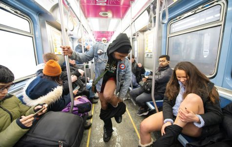 "First-time participants remove their pants for Chicago's 14th annual ""No Pants Subway Ride."" The flash mob was created to promote silliness and spontaneity in everyday life."