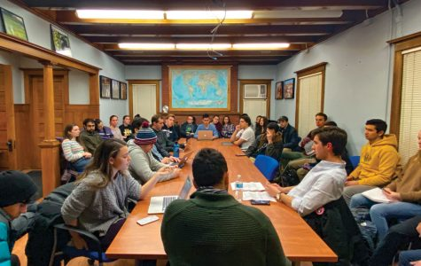 Students at a Political Union meeting. The group narrowly voted in favor of condemning the United States' assassination of Iranian general Qassim Suleimani.