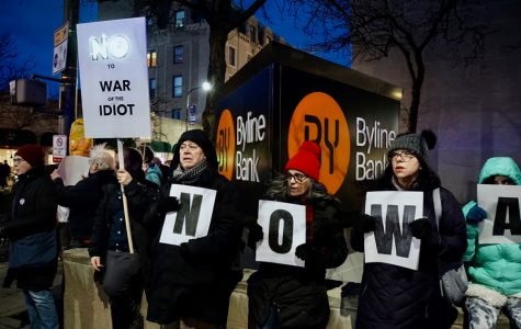 Protesters at the Thursday demonstration organized by Indivisible Evanston. Community members expressed their opposition to President Donald Trump's recent military action in the Middle East.