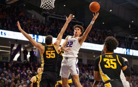 Men's Basketball: Northwestern's Pete Nance outplayed by Iowa center Luka Garza