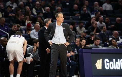 Chris Collins stares down the court. Northwestern now has seven scholarship players healthy.