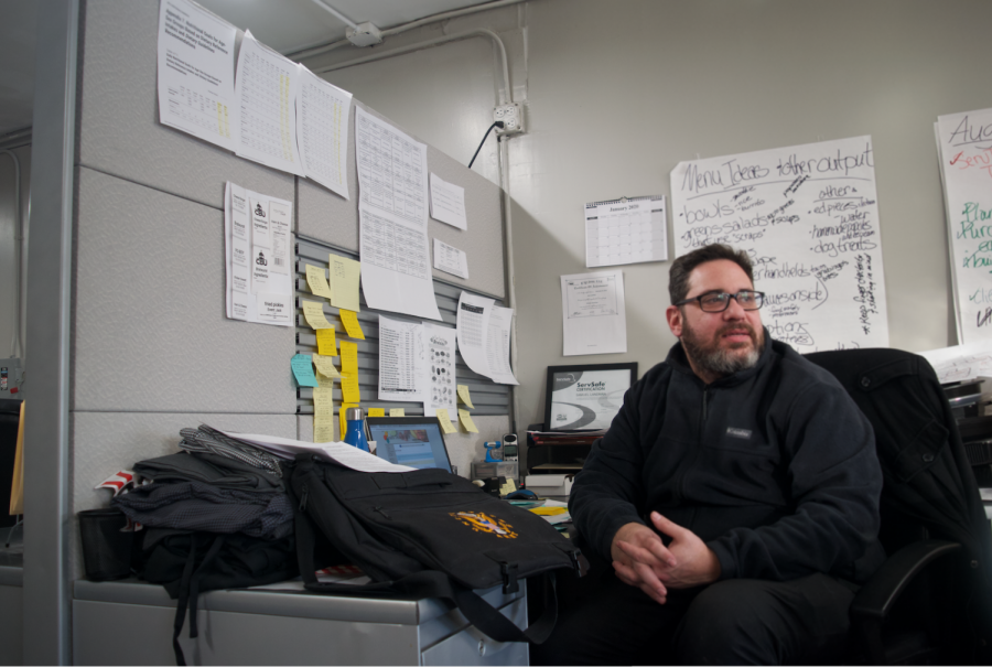 Sam Landman, food service director of Meals on Wheels Northeastern Illinois, works at his desk. Meals on Wheels plans to build a new kitchen and expand to more clients this year.