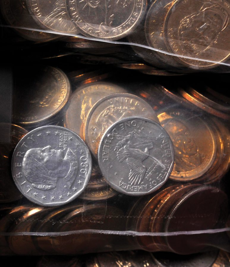 A surplus $1 dollar coins are seen in storage at the Federal Reserve Bank of Richmond in Baltimore, Maryland on August 22, 2011. Evanston small business owners and minimum wage employees expressed concerns with the increased minimum wage.