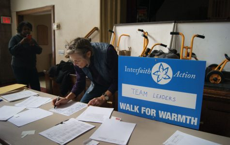 Interfaith Action of Evanston volunteer Birch Burghardt checks in team leaders at the organization's inaugural Walk for Warmth. Participants raised over $20,000 to maintain the six faith communities that host an overnight shelter from mid-November to mid-March.