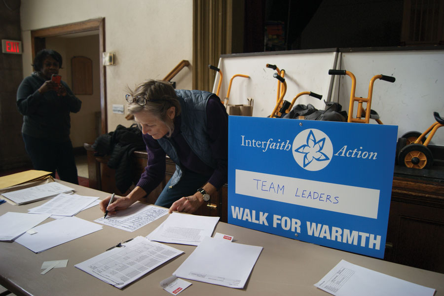 Interfaith+Action+of+Evanston+volunteer+Birch+Burghardt+checks+in+team+leaders+at+the+organization%E2%80%99s+inaugural+Walk+for+Warmth.+Participants+raised+over+%2420%2C000+to+maintain+the+six+faith+communities+that+host+an+overnight+shelter+from+mid-November+to+mid-March.+