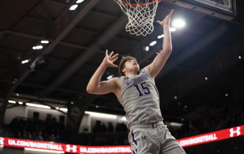 Ryan Young attempts a layup. The freshman center is Northwestern's starter this season.