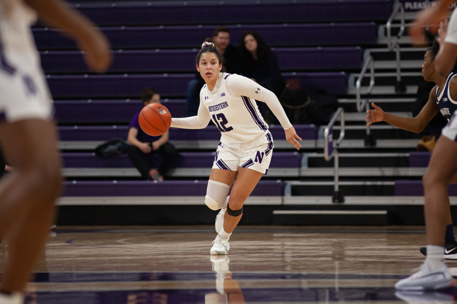 Veronica+Burton+looks+to+make+a+pass.+The+sophomore+guard+finished+with+14+points+in+NU%E2%80%99s+loss+to+Maryland.+