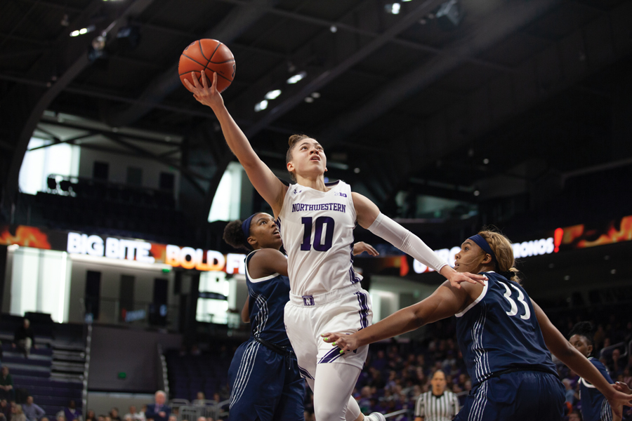 Lindsey Pulliam takes a layup. The junior guard scored 32 points in No. 23 NU's win over the Wolverines.