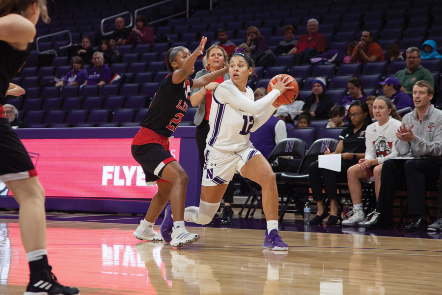 Veronica Burton dribbles the ball. Her play at guard has been one of the keys to NU's fast start this season.