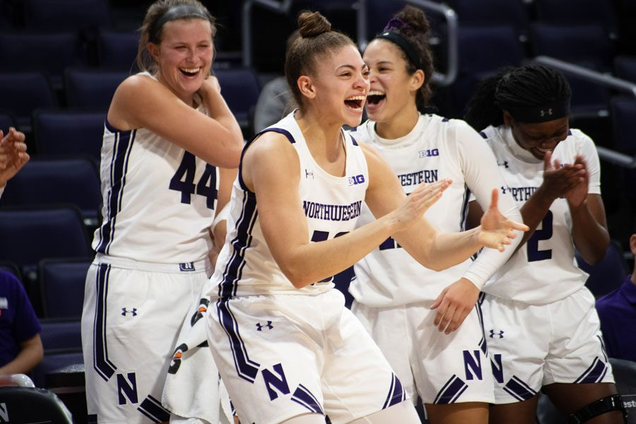 %28Daily+file+photo+by+Joshua+Hoffman%29.+Northwestern+celebrates+on+the+bench.+The+Wildcats+upset+No.+12+Maryland+on+Tuesday.