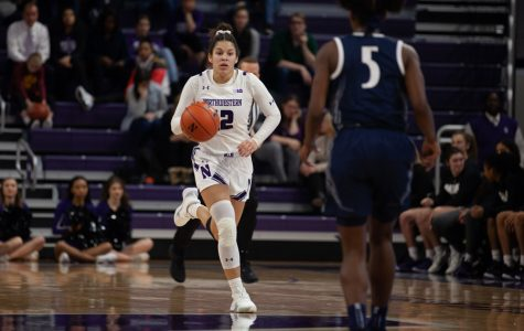 Veronica Burton drives up the court. The sophomore guard scored a game-leading 22 points and also had six steals and eight rebounds on Thursday.
