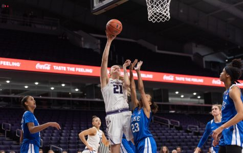 Abbie Wolf goes up for a shot. The senior center scored a career-high 24 points to lead the Cats over Purdue on Sunday.