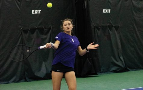 Clarissa Hand hits a forehand. Northwestern had mixed results last weekend in Miami.