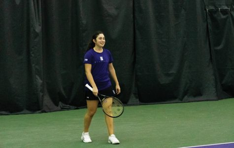 Inci Ogut smiles during a match. The junior beat her singles opponent in two sets on Saturday.