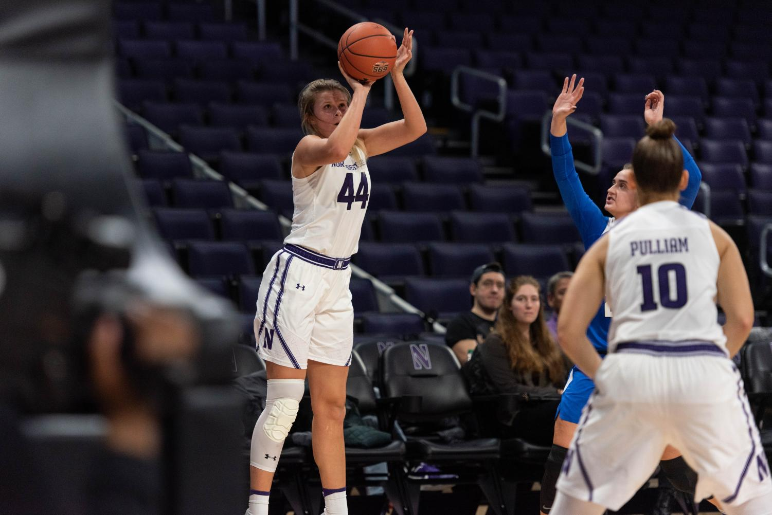 Abi Scheid shoots a three. Northwestern has risen to the top of the Big Ten standings this season.