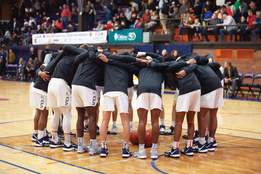 The Evanston Township High School boys varsity basketball team huddles before their game against Loyola Academy on Jan. 28.
