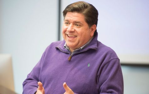 Gov. J.B. Pritzker speaks at an event. The governor proposed two budgets, one for either outcome of November's Illinois Fair Tax referendum.