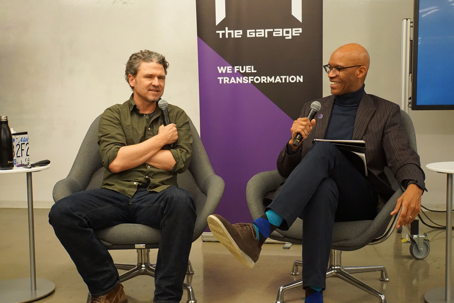 Author Dave Eggers with Medill Dean Charles Whitaker. Eggers spoke in The Garage about his new education non-profit, 826 Valencia.