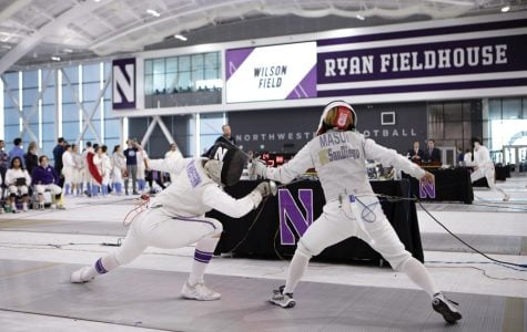 A Northwestern fencer strikes her opponent. The Wildcats went 10-2 in the NU Duals this past weekend.