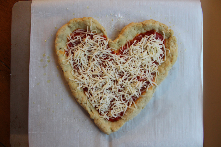 Celebrate Valentine's Day with a homemade heart-shaped pizza