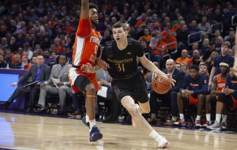 (Joshua Hoffman, The Daily Northwestern). Robbie Beran drives the lane. The freshman forward struggled to score against Illinois.