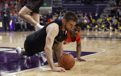 (Joshua Hoffman, The Daily Northwestern). Pat Spencer dives for a loose ball. Coach Chris Collins said he was impressed with Northwestern's fight Thursday.