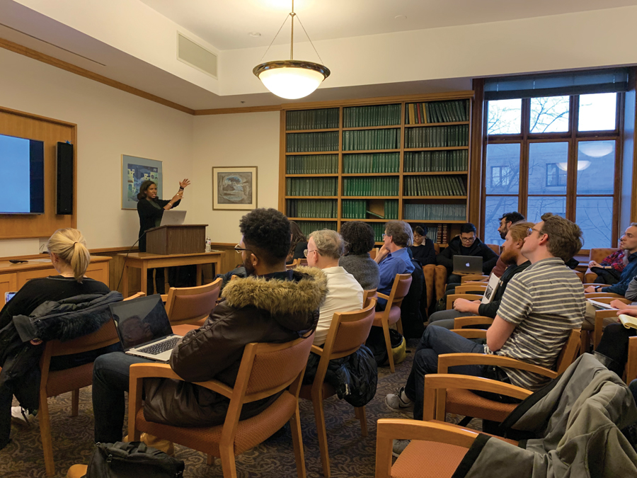 Professor Rana Hogarth gives a talk on her new research in the Hagstrum Room of University Hall on Monday. Her lecture argued that the eugenics movement was motivated by the views of the slavery era.