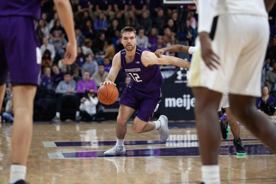 %28Daily+file+photo+by+Joshua+Hoffman%29.+Pat+Spencer+drives+the+lane.+The+grad+transfer+guard+struggled+to+score+Sunday+against+Minnesota