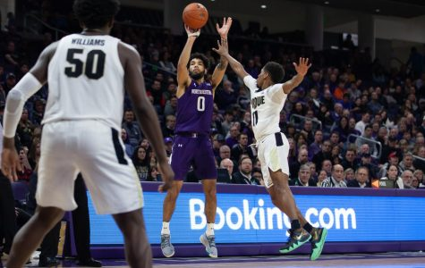 Boo Buie shoots the ball. The freshman guard made three straight threes on Saturday, but the Cats still came up short.