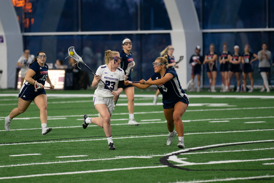 Lindsey+McKone+gears+up+to+shoot.+The+senior+attacker+was+named+Big+Ten+Offensive+Player+of+the+Week+after+scoring+six+goals+and+having+five+assists+in+two+games.