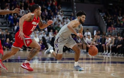 Boo Buie makes a move. NU lost 77-73 to Rutgers in overtime.